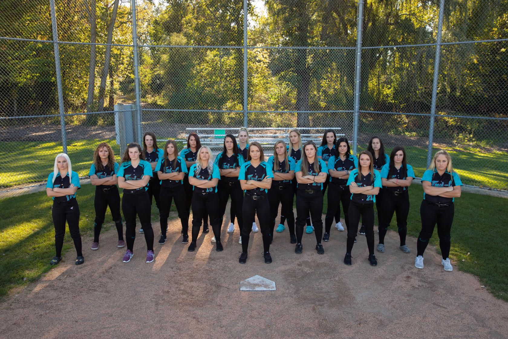 Tri-C softball team standing at home plate