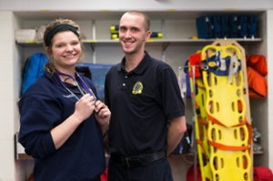 Emergency medical technology cleveland male and female emt students standing next to each other xflitez Gallery